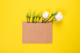 Eustoma flower arrangement with flowers and blank card, on yellow background
