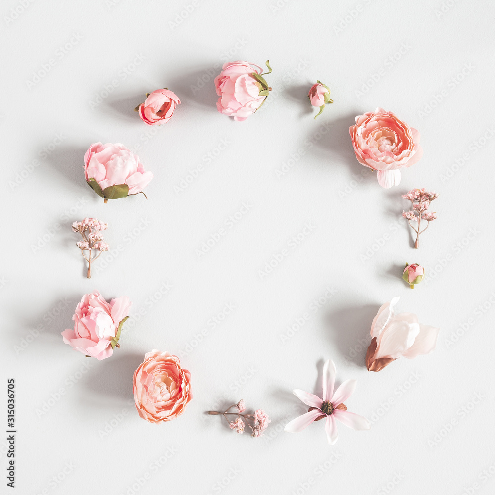 Fototapeta Flowers composition. Wreath made of pink flowers on pastel gray background. Valentines day, mothers day, womens day concept. Flat lay, top view, copy space, square