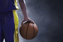 Basketball Player Holding A Ball