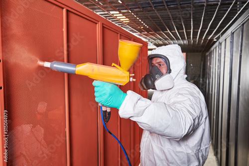 Fotomural polymer coating of metal detail with powder spraying gun