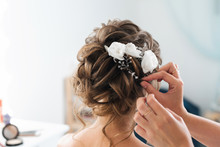 Hairdresser Makes An Elegant Hairstyle Styling Bride With White Flowers In Her Hair