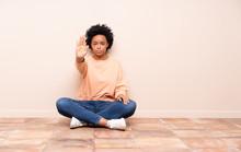 African American Woman Sitting...