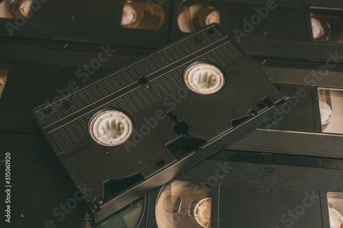 Valokuvatapetti Old VHS videocassette tapes as background. Retro technology.