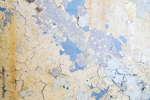 OLd weathered wall with peeling paint