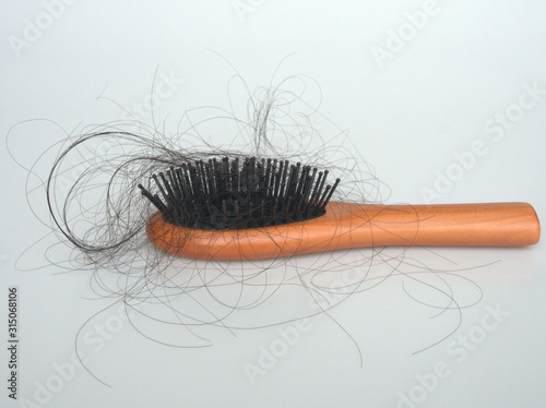 Fotografie, Tablou  Hair falling out is on the brush with the white background