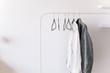 Leinwanddruck Bild - Clothes hanging against white wall.