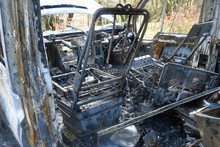 Fire Damaged Van Showing Burned Out Seats And Dashboard With Complete Fire Damage.