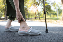 Closeup Of Legs Of Senior Woman Feeling Pain In The Joints Bones,ankle Tendon Injury,gout Disease,osteoarthritis,ligament And Muscle Problems,elderly People Touching Ankle Due To Sprain After Walk