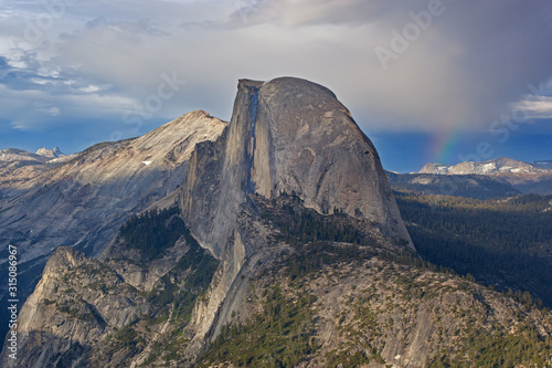 Landscape of a rainbow, Half Dome and the Sierra Nevada Mountains from Glacier Point, Yosemite National Park, California, USA