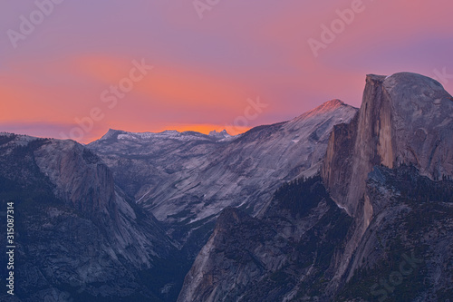 Landscape of Half Dome and the Sierra Nevada Mountains at twilight from Glacier Point, Yosemite National Park, California, USA