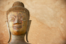 Face Of An Ancient Copper Buddha Statue Outside Of The Hor Phra Keo Temple (former Temple Of The Emerald Buddha) In Vientiane, Laos.