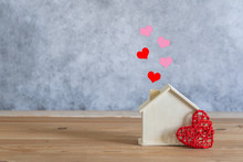 Accessories Of Decorations Valentine's Day Holiday Background Concept.Essential Items Colorful Pastel Love Shape With Wooden House On Modern Rustic Brown Wooden.Copy Space For Creative Design Text.