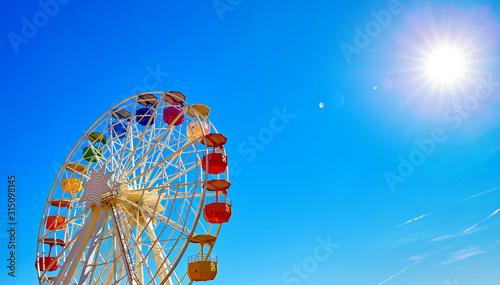 Fototapeta Ferris wheel on Mount Tibidabo Spain Barcelona. Sunny day with blue sky aerial view. obraz