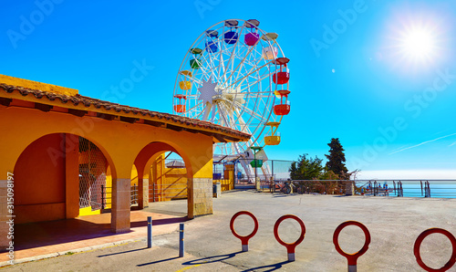 Entrance in amusement park at Mount Tibidabo Barcelona Spain with Ferris wheel attraction Wallpaper Mural