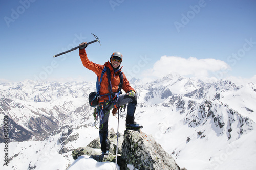 Photo alpinism in the snowy mountains