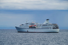 Small Classic White Cruiseship Or Cruise Ship Liner Ocean Majesty Of Majestic Cruises On Blue Sea With Stormy Clouds
