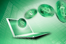 Green Bitcoins And Laptop