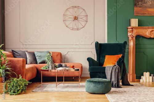 Εκτύπωση καμβά Stylish copper colored coffee table in front of comfortable corner sofa in trend