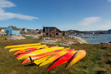 Vibrant Colored Kayaks In Grass Disko Bay West Greenland