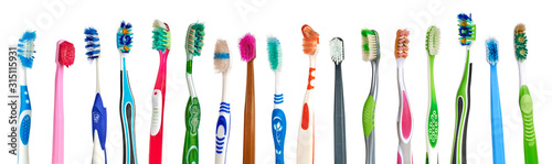 Old, used and dirty colorful toothbrushes on white background Fototapeta