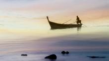 Fisherman In Calm Twilight Wat...
