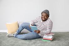 African-American Man Reading B...