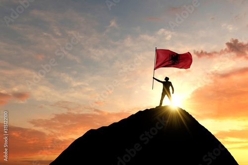 Albanian flag being waved at the top of a mountain summit Canvas Print