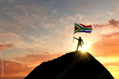 Fototapeta South Africa flag being waved at the top of a mountain summit. 3D Rendering obraz