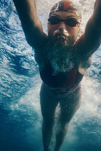 Professional Swimmer Moving Fa...