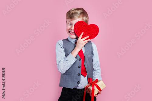 Fototapeta Charming little boy posing with heart on pink background obraz