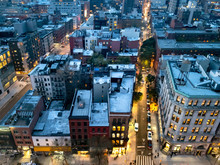 Overhead View Of The Busy Streets Of Nolita And SoHo Neighborhoods With Colorful Night Lights Shining At Dusk In Manhattan, New York City