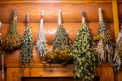 Fotomural Dried herbs and branches on wooden background of russian bathhouse