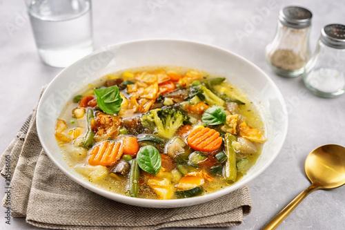 Fototapeta Detox vegan vegetable soup on light background obraz