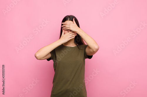 young pretty woman covering face with both hands saying no to the camera! refusi Canvas-taulu