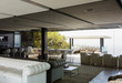 Cabana and modern living room reflected in mirror