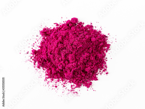 Fototapeta Dragon fruit powder heap isolated on white with clipping path. Perfect bright magenta freeze dried pitahaya cactus or Hylocereus costaricensis powder. Top down view or flat lay obraz