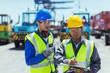 Workers talking near trucks