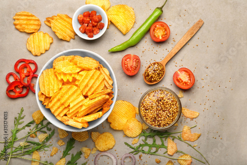 Obraz Composition with tasty potato chips on table - fototapety do salonu