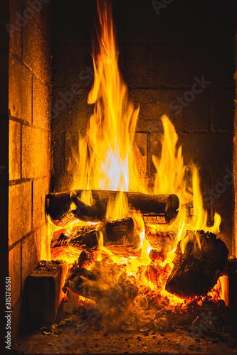Flames burning a bonfire with coals, fireplace, close-up
