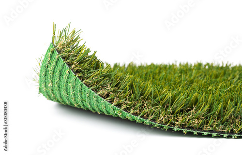 Photo Flipped Up Section of Artificial Turf Grass On White Background