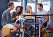 Friends hanging out in cafe behind bicycle