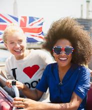 Portrait Enthusiastic Friends British Flag Riding Double-decker Bus