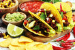 canvas print picture - Mexican tacos with beef, tomatoes, avocado, chilli and onions. Handmade tortilla with pork