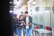 College students discussing homework in corridor