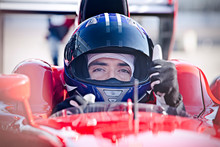 Portrait Confident Male Formula One Race Car Driver Gesturing Thumbs-up