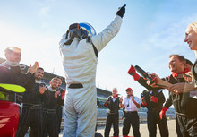 Formula One Racing Team Driver Cheering, Celebrating Victory On Sports Track