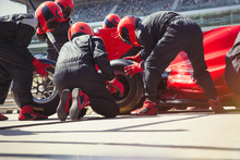 Pit Crew Replacing Tires On Fo...