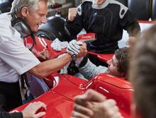 Manager Formula One Race Car Driver Handshaking, Celebrating Victory