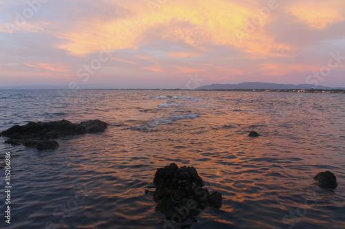 Fototapeta Sunset in Monte Argentario (Baths of Domitian beach)