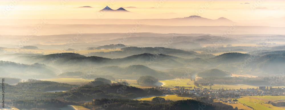 Fototapeta Bezdez twin mountains rising from the mist. Weather temperature inversion, Czech Republic